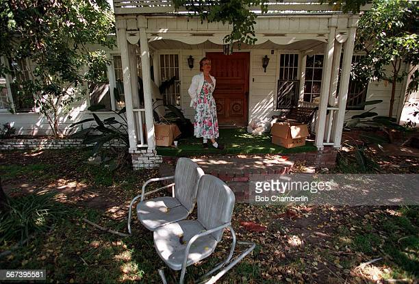 Laurel.1.05–01.BC.a.Odette Leonelli outside front door of bungalow at 2401 Curtis Ave on 05/01/97 in Redondo Beach which may have been owned by...