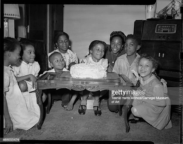Melba Lee Mitchell celebrating her sixth birthday with guests including Barbara Williams Roxian Riles Alfred Harris Shirley Skelton Clara Lee Skelton...