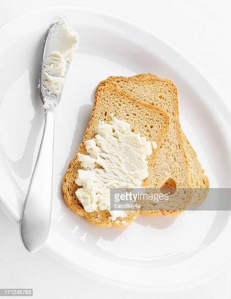 melba toasts and cheese - spreading stock pictures, royalty-free photos & images