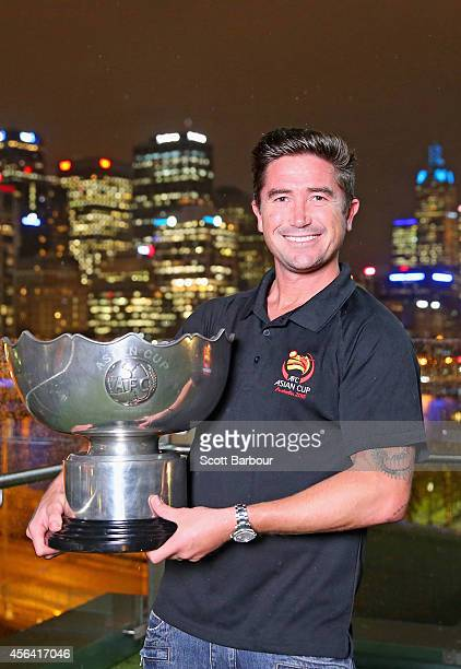 Melbourne Asian Cup Ambassador Harry Kewell poses with the Asian Cup at the Asian Cup Ambassador announcement on September 24 2014 in Melbourne...