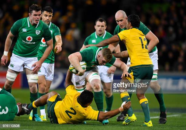 Melbourne Australia 16 June 2018 Dan Leavy of Ireland is tackled by Brandon PaengaAmosa left and Kurtley Beale of Australia during the 2018...
