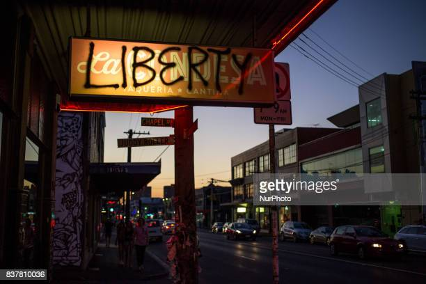 Melbourne Australia 18 march 2017 A view of a shop sign tagged with de word liberty in a street of the Fitzroy district Melbourne is ranked as the...