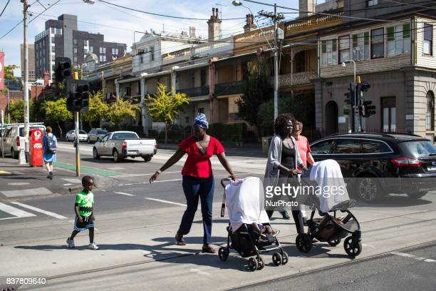 Melbourne Australia 20 march 2017 Two refugees walk their child in the street of fitzroy Melbourne is ranked as the worlds most liveable city for the...