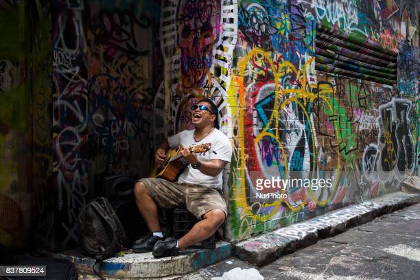 Melbourne Australia 21 march 2017 A man sing out loud with his guitar in a tiny street of the central business district Melbourne is ranked as the...