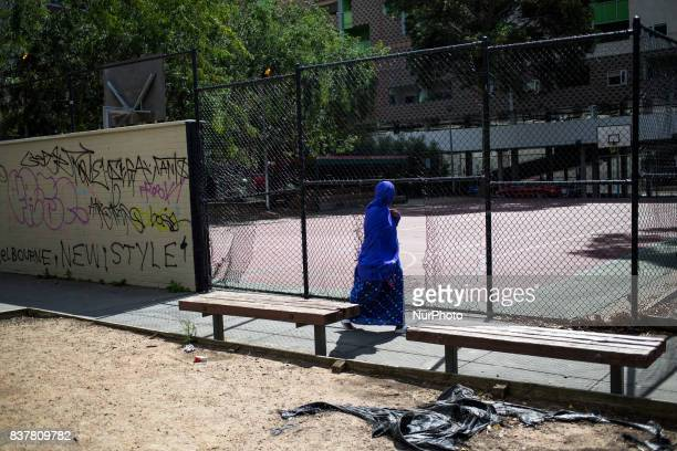 Melbourne Australia 25 march 2017 A refugee woman wearing the hijab walks in a park near the Fitzroy district Melbourne is ranked as the worlds most...