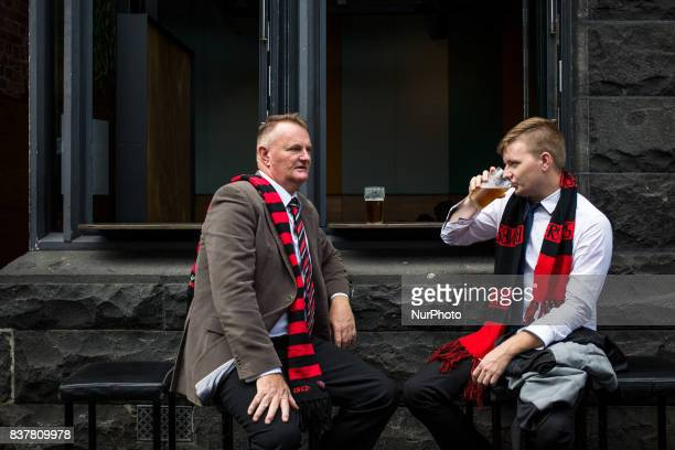 Melbourne Australia 25 march 2017 Two Australian football supporters drink a beer in a bar of the central business district Melbourne is ranked as...