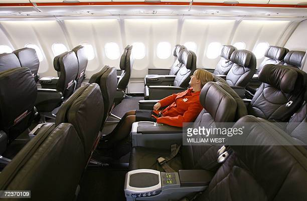 A Jetstar flight attendant relaxes in a business type seat available at economy prices as Jetstar unveils 03 November 2006 the first of their four...