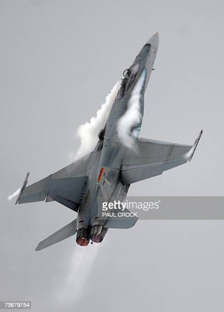 A Royal Australian Air Force F/A18 performs during the first public session of the Australian International Airshow in Melbourne 23 March 2007 Around...