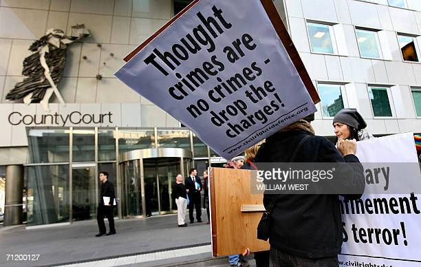 A small group of vocal protesters today rally in Melbourne's law courts precinct against the use of the federal government's new terror laws ahead of...