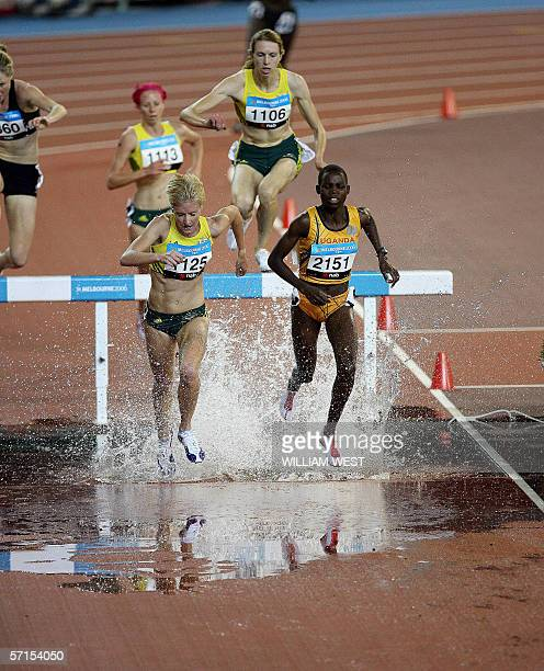 Athletes compete during the women's steeplechase final at the Commonwealth Games 22 March 2006. Uganda's Dorcus Inzikuru won the race ahead of...