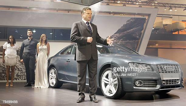 Audi's Australian managing director Joerg Hofmann Australian Olympic champions in athletics and swimming Cathy Freeman and Ian Thorpe along with an...