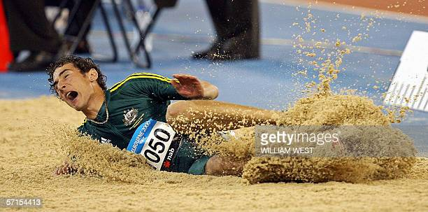 Australian Fabrice Lapierre of Australia lands in the sand on the way to winning the bronze medal in the Men's Long Jump at the 18th Commonwealth...