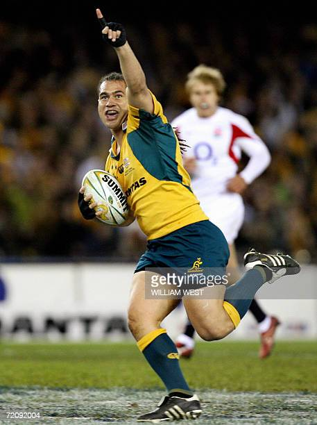 Australian flanker George Smith powers to the line to score Australia's first try against England in the second Test Match being played at...