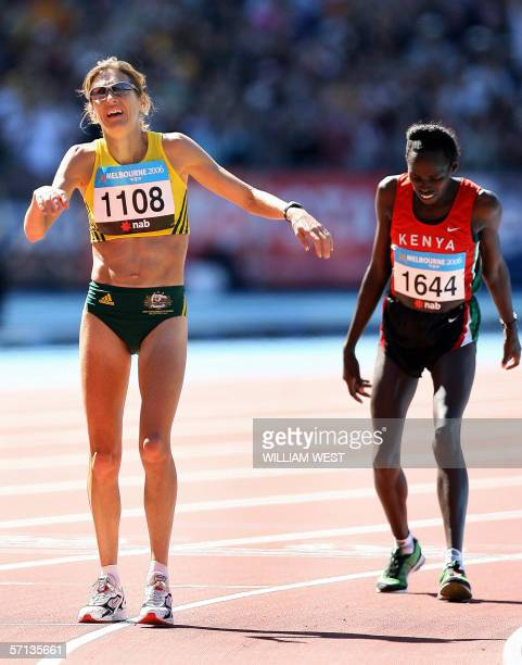 Australian Kerryn McCann reacts after crossing the finish line ahead of Kenyan Hellen Cherono Koskei in the women's marathon finals during the...