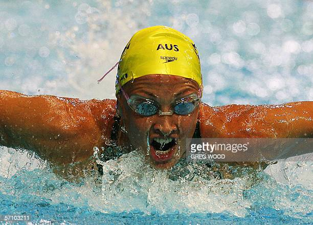 Australian Stephanie Rice powers during the women's 200m individual medley finals to win gold ahead of her compatriots Brooke Hanson for silver and...