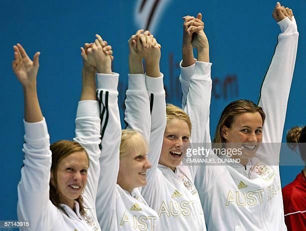 Australian swimmers Lisbeth Linton Jessicah Schipper Leisel Jones and Sophie Edington celebrate after breaking the world record in the women's 4x100m...