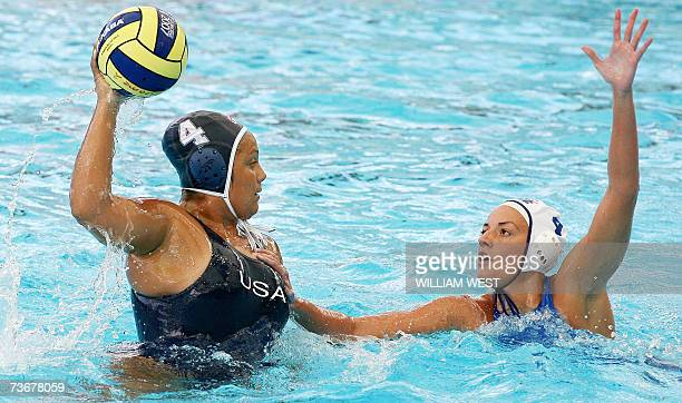 Brenda Villa of the US prepares to get a pass away under pressure from Sofia Iosifidou of Greece during the preliminary rounds of the women's water...
