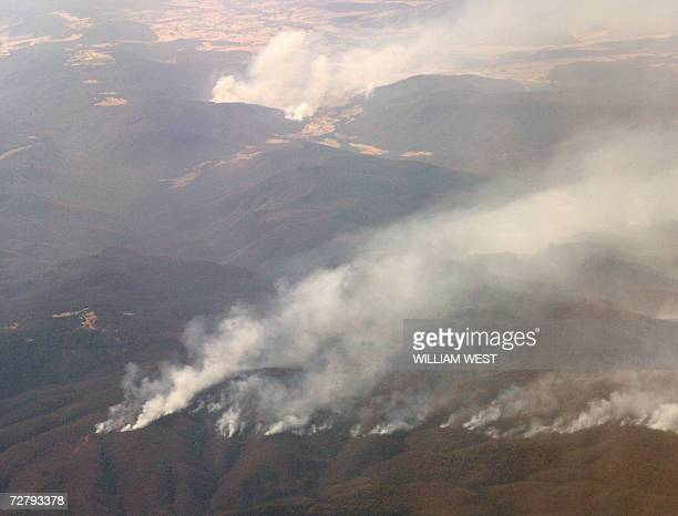 Bushfires snake throught the hills in northern Victoria as more than 3000 firefighters battled some of Australia's worst wildfires in 70 years while...