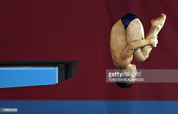 Canada's Alexandre Despatie performs an inward 3 1/2 somersault during the men's 10m platform diving final at the 12th FINA World Swimming...