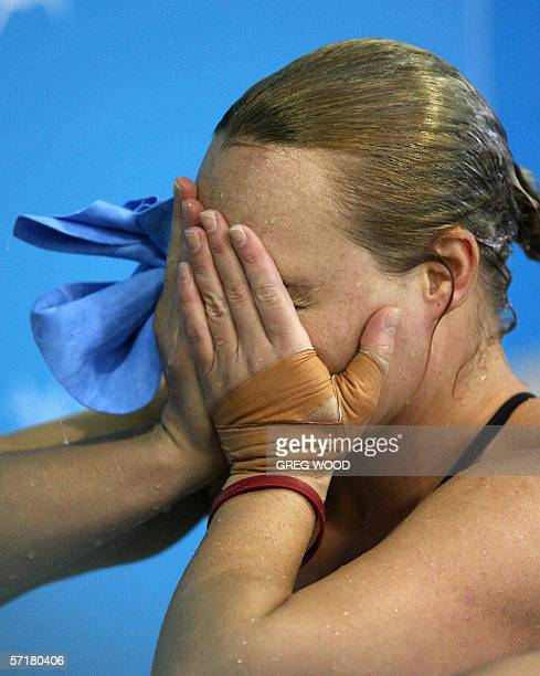 Canada's Blythe Hartley is emotional after realising she has won gold in the Commonwealth Games women's 3m springboard final at the Melbourne Sports...