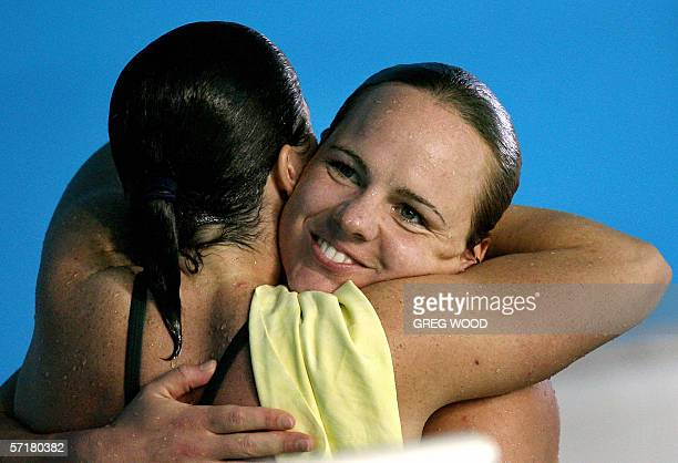 Canada's Blythe Hartley is hugged by Australia's Chantelle Newbery after she had won gold in the Commonwealth Games women's 3m springboard final at...