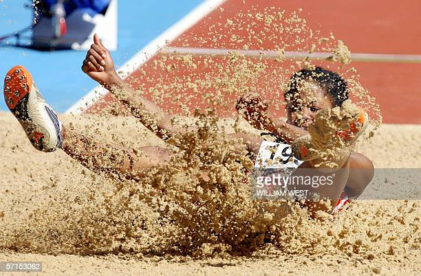 Celine Laporte of Seychelles sets the 12th longest distance in the Women's Long Jump qualifying during the Athletics at the 2006 Melbourne...