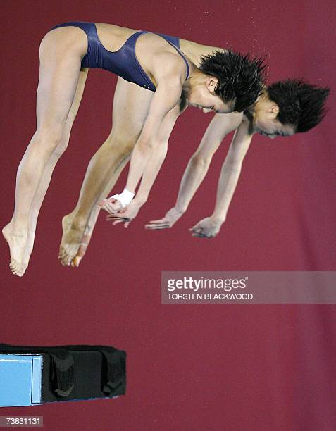 China's Jia Tong and Chen Ruolin launch into a forward 3 1/2 sommersault from pike position during the women's 10m synchro platform diving final at...