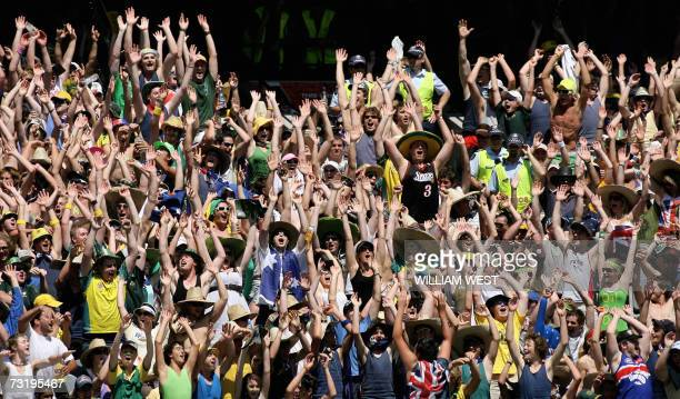 Cricket fans perform the 'Mexican Wave' after ground authorities and police banned the wave from the Australia New Zealand one day game being played...