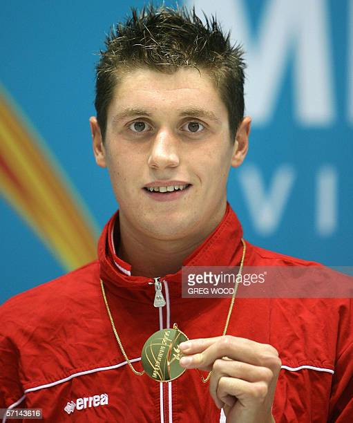 David Davies of Wales shows off his gold medal following his victory in the men's 1500m freestyle final at the Commonwealth Games in Melbourne 21...