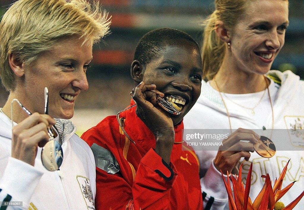 Dorcus Inzikuru (C) of Uganda bites her : News Photo