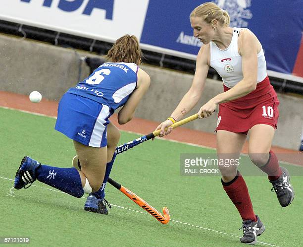 England forward Lucilla Wright chips past Scottish midfielder Julie Kilpatrick during their women's field hockey preliminary match at the...