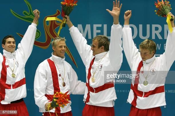 England's 4x200m freestyle swimming team of Simon Burnett Alexander Scotcher Dean Milwain and Ross Davenport celebrate their win in the Commonwealth...
