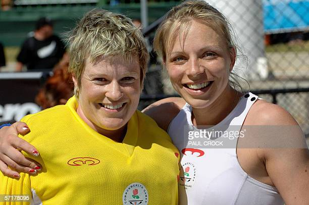 England's goalkeeper Carolyn Reid and captain Kate Walsh smile while posing after winning the bronze medal over New Zealand in the women's field...