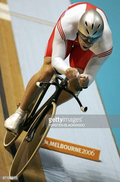England's Jason Queally powers his way to silver in the final of the men's 1km time trial cycling at the Commonwealth Games in Melbourne, 16 March...