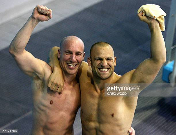 England's Mark Shipman and Antonio Ally celebrate after completing their last dive to win silver in the Commonwealth Games men's 3m synchronised...