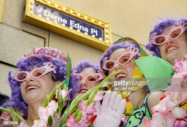 Four Dame Edna Everage lookalikes pose under the street sign as city laneway in Melbourne's CBD was being renamed 'Dame Edna Place' in honour of the...