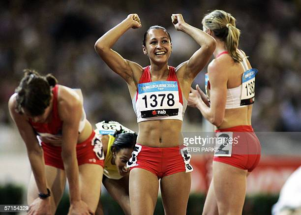 Jessica Ennis of England reacts after her teammate Kelly Sotherton won the heptathlon title at the Commonwealth Games in Melbourne as teammate Julie...