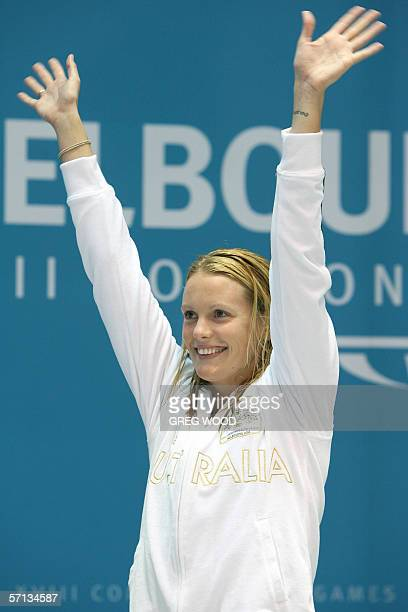 Joanna Fargus of Australia waves on the podium following her victory in the women's 200metres backstroke final at the Commonwealth Games in Melbourne...