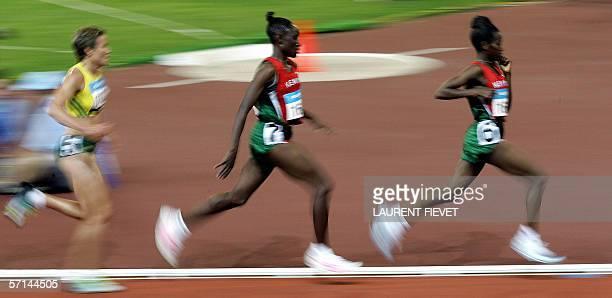 Kenyan Lucy Wamgui Kabulu leads her countrywomen Eveline Wambui Nganga and Australian Benita Johnson during the women's 10000-m final for the...