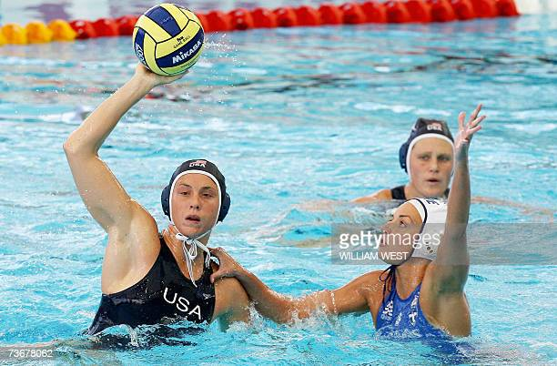 Lauren Wenger of the US prepares to get a pass away under pressure from Sofia Iosifidou of Greece during the preliminary rounds of the women's water...