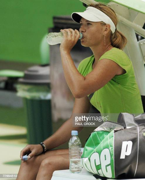 Maria Sharapova of Russia drinks water during a practice session in Melbourne 14 January 2007 ahead of the forthcoming Australian Open tournament AFP...