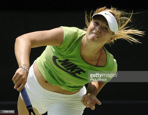 Maria Sharapova of Russia serves during a practice session in Melbourne 14 January 2007 ahead of the forthcoming Australian Open tournament AFP...