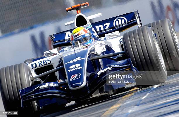 Mark Webber of Australia runs his Williams Cosworth wide on to the ripple strip during qualifying for the Australian Formula One Grand Prix in...