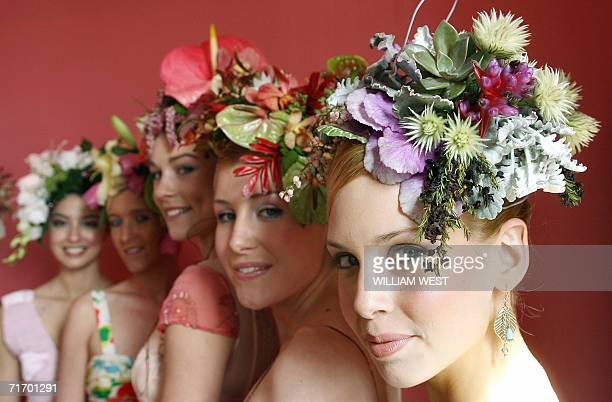 Models pose with their hair designs by hairdresser Aldo Raymond and incorporating flowers from florists 'Flower Flower' as Melbourne prepares itself...