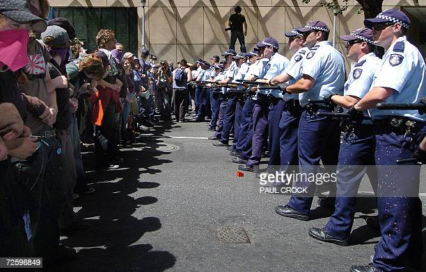 Police and protestors faceoff during the violent protest at the G20 finance summit in Melbourne 18 November 2006 Police armed with batons and riot...