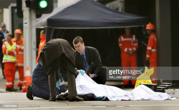 Police inspect the scene where a man was killed and two people wounded in a shooting in the centre of Melbourne during rushhour 18 June 2007 Police...