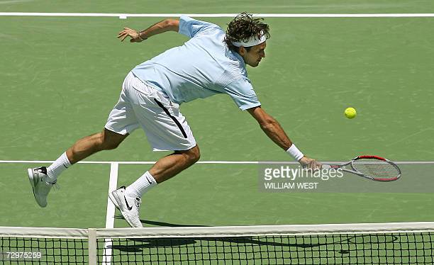 Roger Federer lunges for a backhand volley against Russian Marat Safin at the Kooyong Classic in Melbourne 11 January 2007 Federer won 63 76 Eight of...