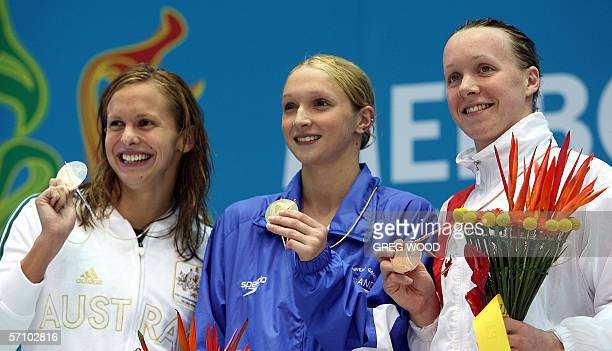 Scotish Caitlin McClatchey Australia's Lisbeth Lenton and England's Melanie Marshall show their medals for the women's 200m freestyle finals at the...