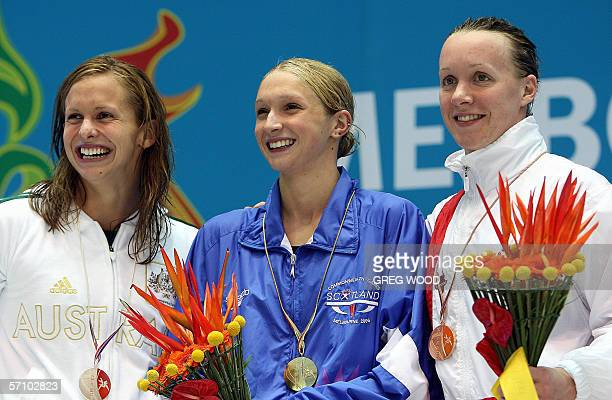Scotish Caitlin McClatchey Australia's Lisbeth Lenton and England's Melanie Marshall are all smile after receiving their medals for the women's 200m...