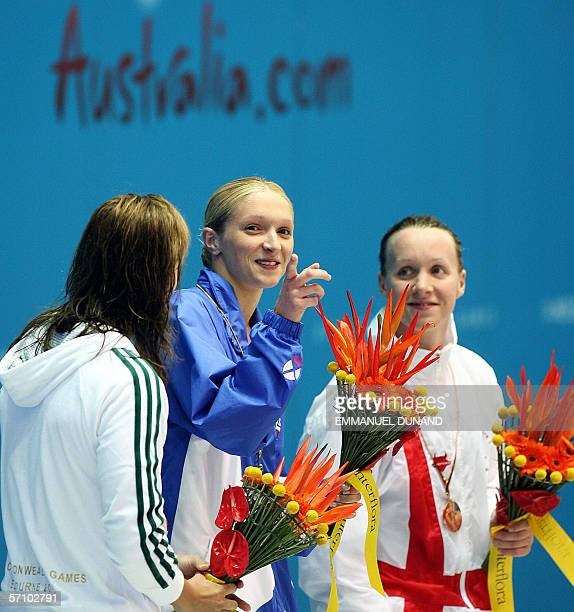 Scotish Caitlin McClatchey chats with Australia's Lisbeth Lenton and England's Melanie Marshall during the medal ceremony for the women's 200m...